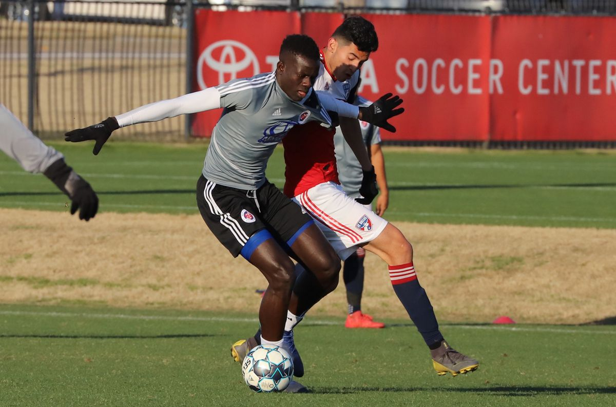 Alfusainey Jatta of North Texas SC (in grey) fights off Ricardo Pepi playing for the FCD U19s. (3-6-19(