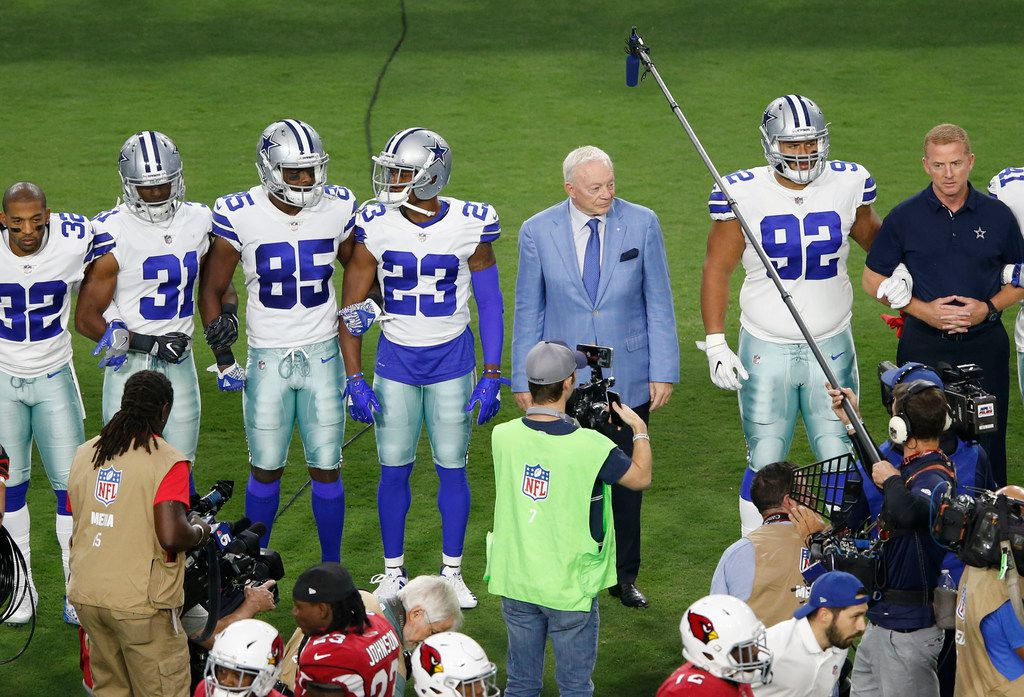 Dallas Cowboys owner and general manager Jerry Jones waits for the team to link arms before the singing of the National Anthem prior to the start of a game against the Arizona Cardinals at University of Phoenix Stadium in Glendale, Arizona on Monday, September 25, 2017. (Vernon Bryant/The Dallas Morning News)