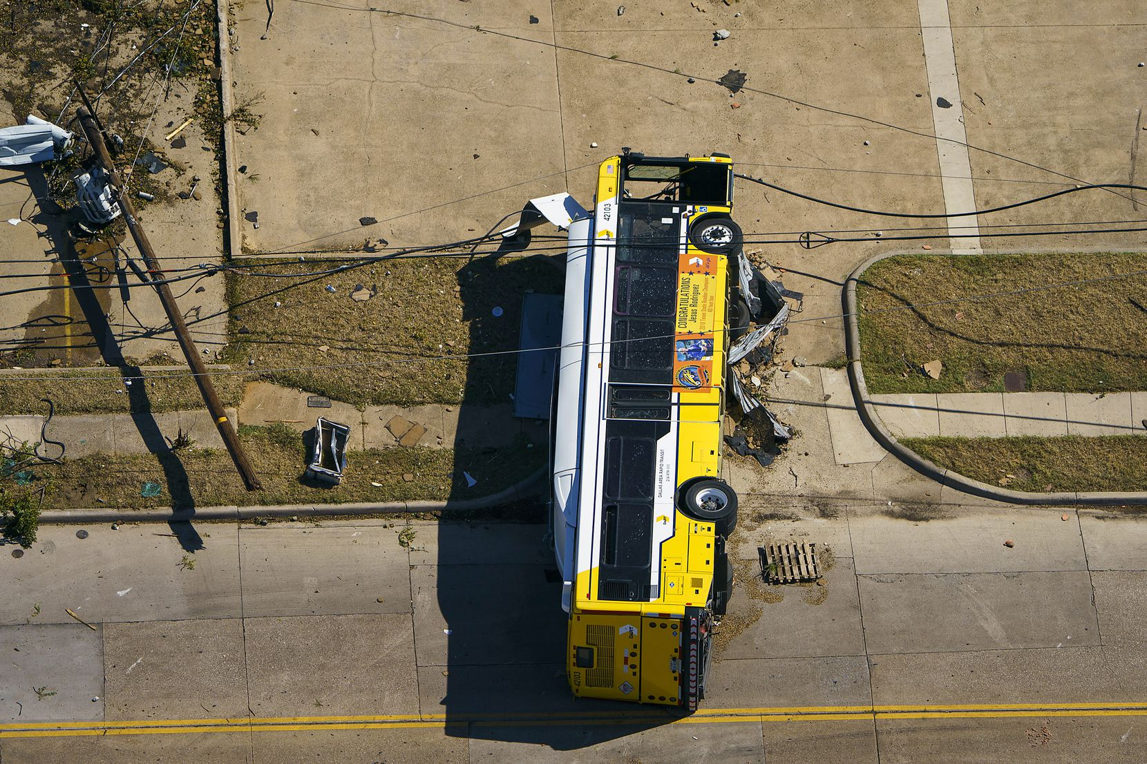 A overturned DART bus is seen near Walnut HIll Lane and Denton Drive on Monday, Oct. 21, 2019, in Dallas.