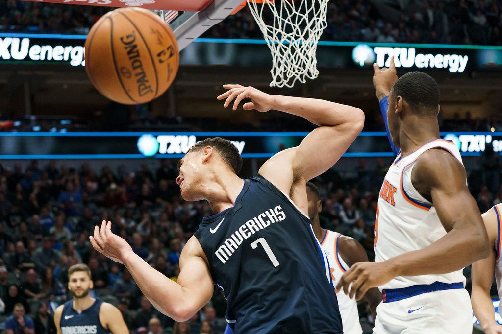 Dallas Mavericks forward Dwight Powell (7) is fouled by New York Knicks guard RJ Barrett (9) during the first half of an NBA basketball game at American Airlines Center on Friday, Nov. 8, 2019, in Dallas. (Smiley N. Pool/The Dallas Morning News)