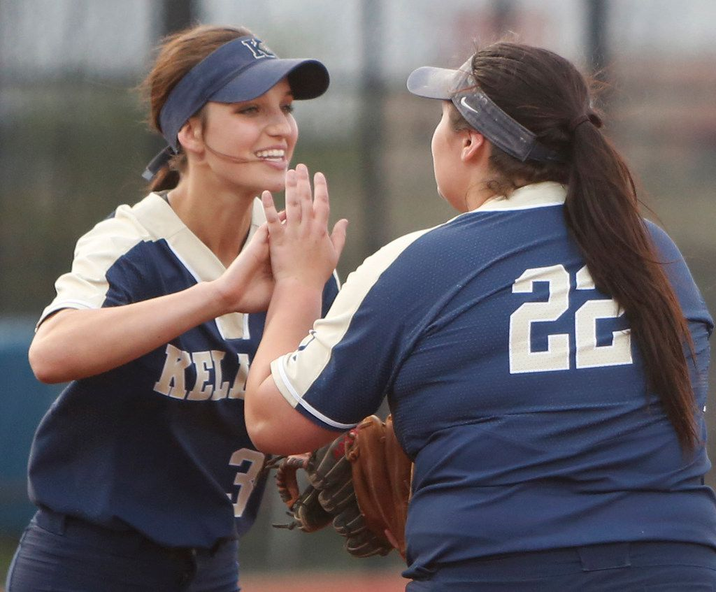 Keller third baseman Riley Love (left) and pitcher Dylann Kaderka celebrate after Love threw out a Northwest Eaton batter after fielding a grounder and firing to first during Keller's 4-3 win on April 5,. (Steve Hamm/ Special Contributor)