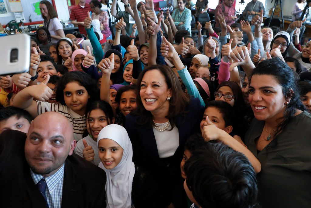Democratic presidential candidate Sen. Kamala Harris, D-Calif., (center) poses with students at Miller Elementary School in Dearborn, Mich., on May 6, 2019.