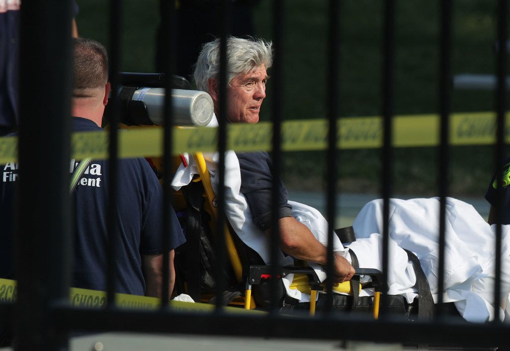 ALEXANDRIA, VA - JUNE 14:  U.S. Rep. Roger Williams (R-TX) is wheeled away by emergency medical service personnel from the Eugene Simpson Stadium Park June 14, 2017 in Alexandria, Virginia. U.S. House Majority Whip Steve Scalise (R-LA) was among five wounded in the attack, including the suspected gunman, as Republican Congressional members practiced for a charity baseball game.  (Photo by Alex Wong/Getty Images)