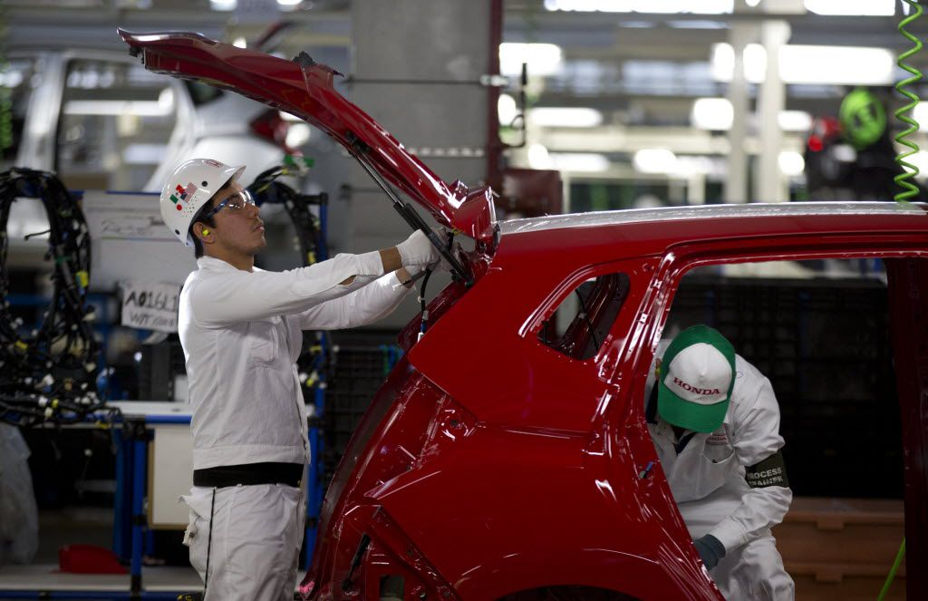 Employees at work in the new multibillion-dollar Honda car plant in Celaya, in the central Mexican state of Guanajuato.