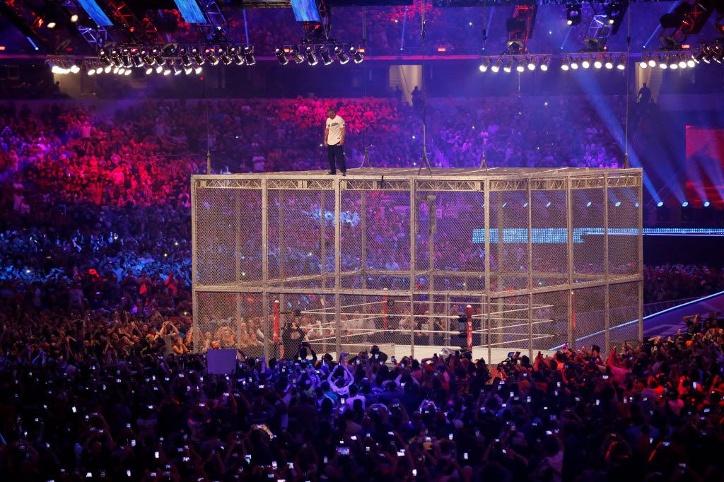 Shane McMahon prepares to jump from the top of the cage onto The Undertaker in the Hell In A Cell event during WrestleMania 32 at AT&T Stadium in Arlington, TX, Sunday, April 3, 2016. (David Guzman/The Dallas Morning News)