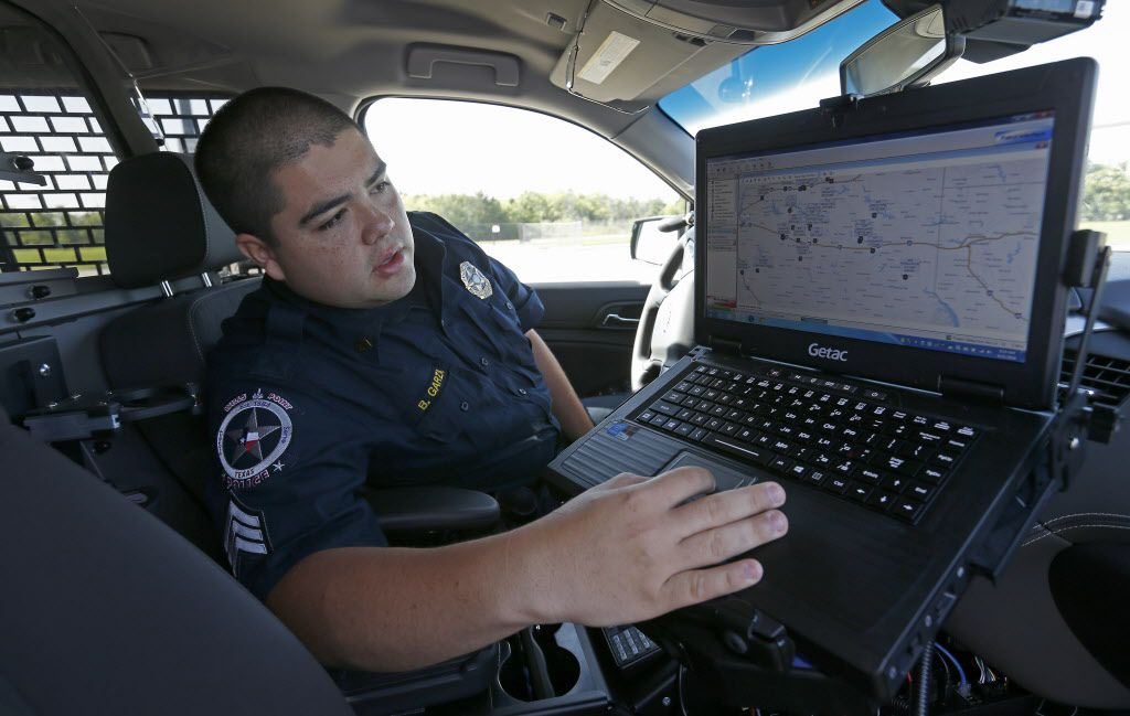 Sgt. Bernardo Garza, of the Wills Point Police Department, shows how to use a COPsync software inside his patrol car at Forney Community Park in Forney, Texas, Tuesday, June 21, 2016. The COPsync software allows officers to access local, state and federal law enforcement databases, gather information at the point of incident and share the data with all other officers on the COPsync Network in their patrol car. (Jae S. Lee/The Dallas Morning News)