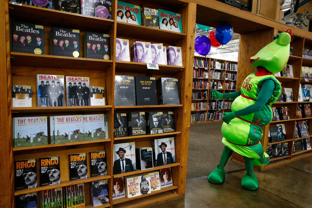 Bookworm gets balloons stuck on one of the shelves of Half Price Books during the 45th anniversary celebration at the store at Northwest Hwy in Dallas on July 27.