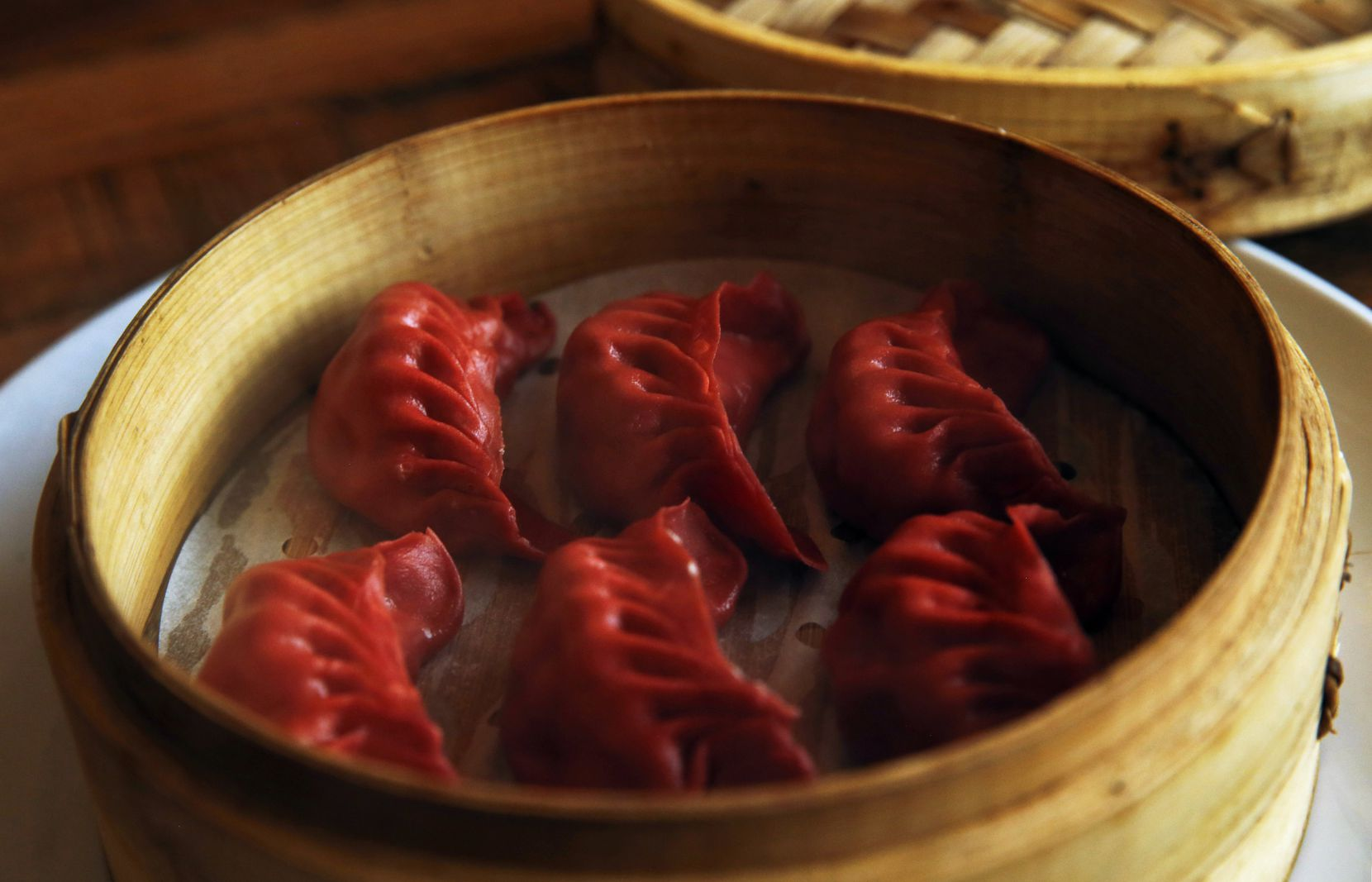 Three Delicacy dumplings are filled with shrimp, scallop, pollock and pork (that's four, but who's counting). The wrapper is tinted with beet.
