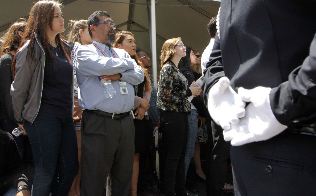 Severo Perez, center, criminal justice instructor, Yvonne A. Ewell Townview Center stands with his students during the annual service for fallen officers, Wednesday, May 17, 2017.  (David Woo/The Dallas Morning News)