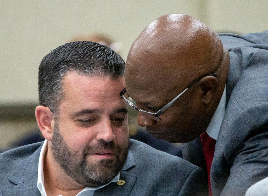 Deputy Mayor Pro Tem and Dallas council member Adam McGough (left) of District 10 listened to Tennell Atkins of District 8 during a City Council briefing on Monday.