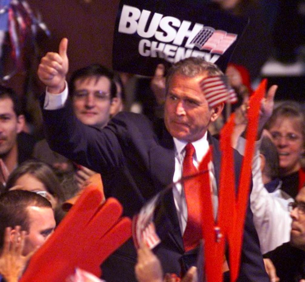 Then-Gov. George W. Bush arrives at a welcome rally at Austin-Bergstrom International Airport late Monday night on the eve of election day Tuesday Nov. 7, 2000..