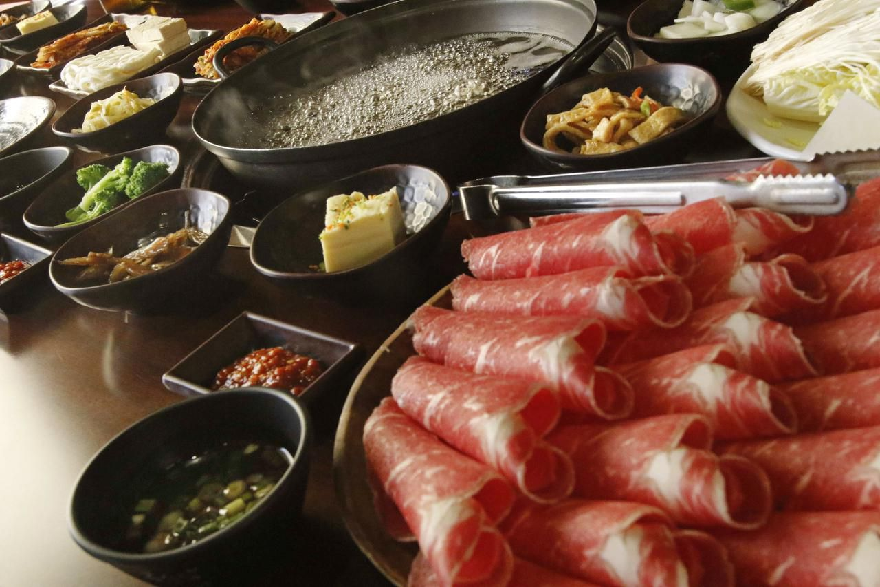"""The table is set for a Korean favorite: """"Shabu shabu is what I call festive food,"""" says restaurateur Sammantha Kang. """"It is eaten slowly and encourages gathering and communion."""""""