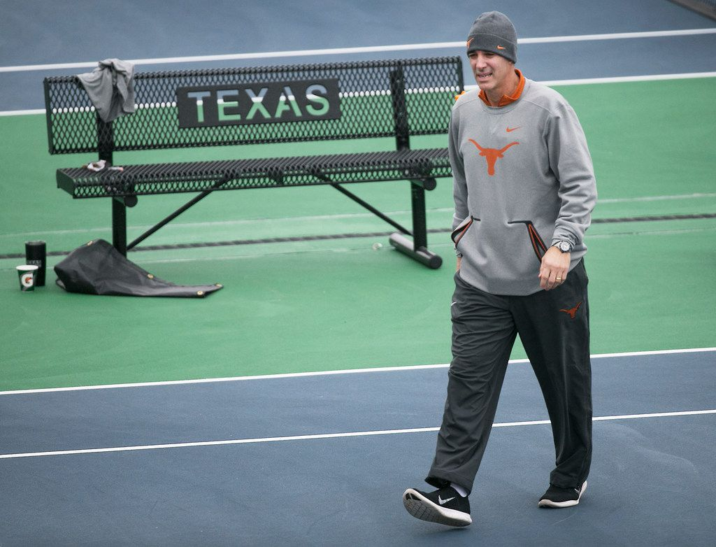 In this January 2018 photo, Texas men's tennis coach Michael Center surveys the courts before the matches with UTSA, in Austin.