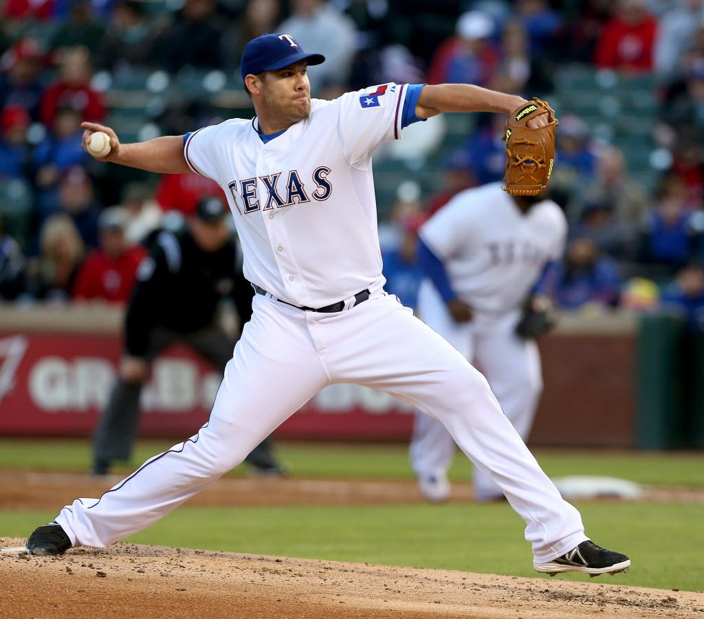 Texas Rangers starting pitcher Colby Lewis (48) in the second inning of MLB Baseball action against the Seattle Mariners at Globe Life Park in Arlington, Texas on Monday, April 14, 2014.