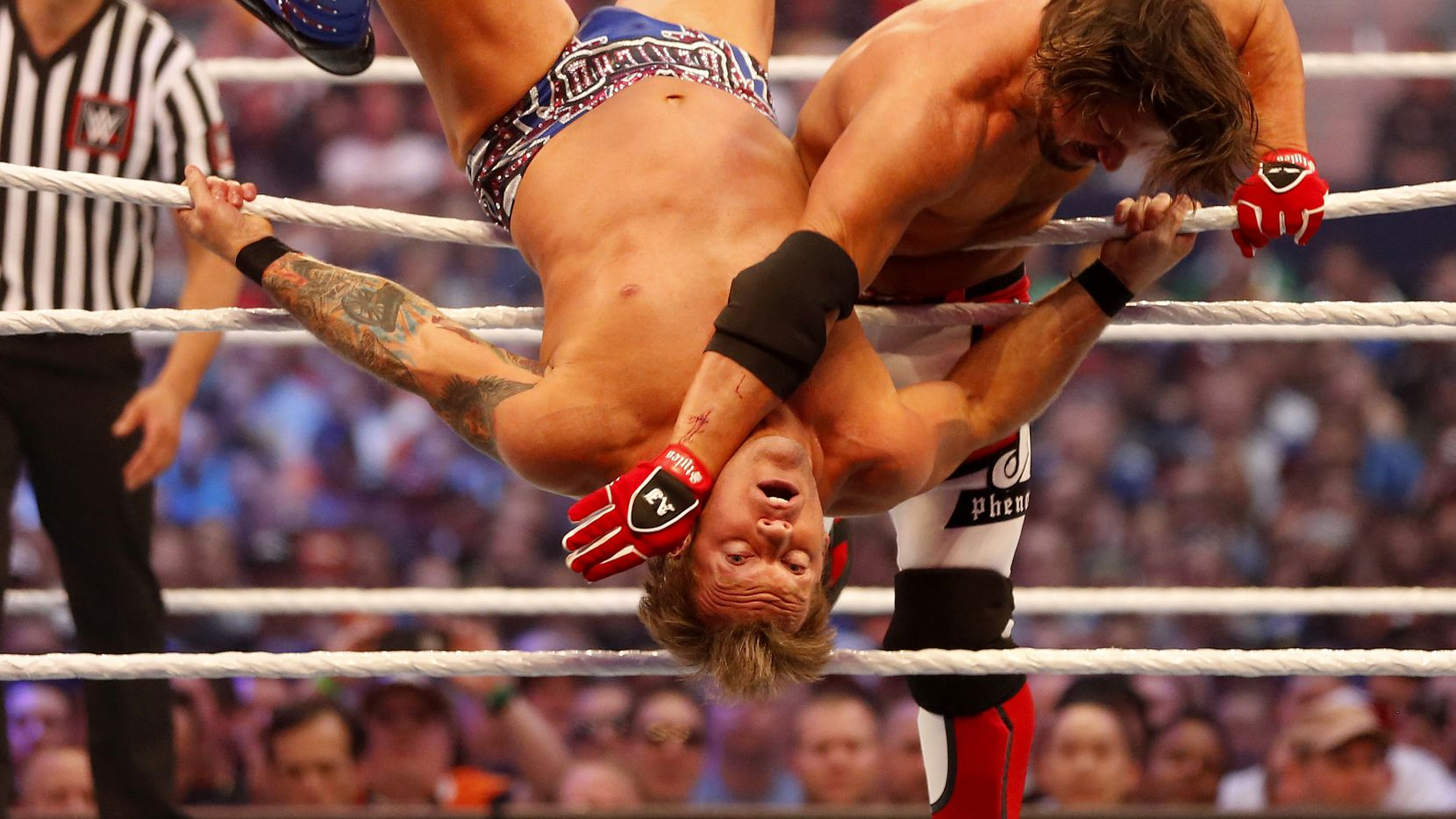 AJ Styles (right) wrestles with Chris Jericho during WrestleMania 32 at AT&T Stadium in Arlington in April.