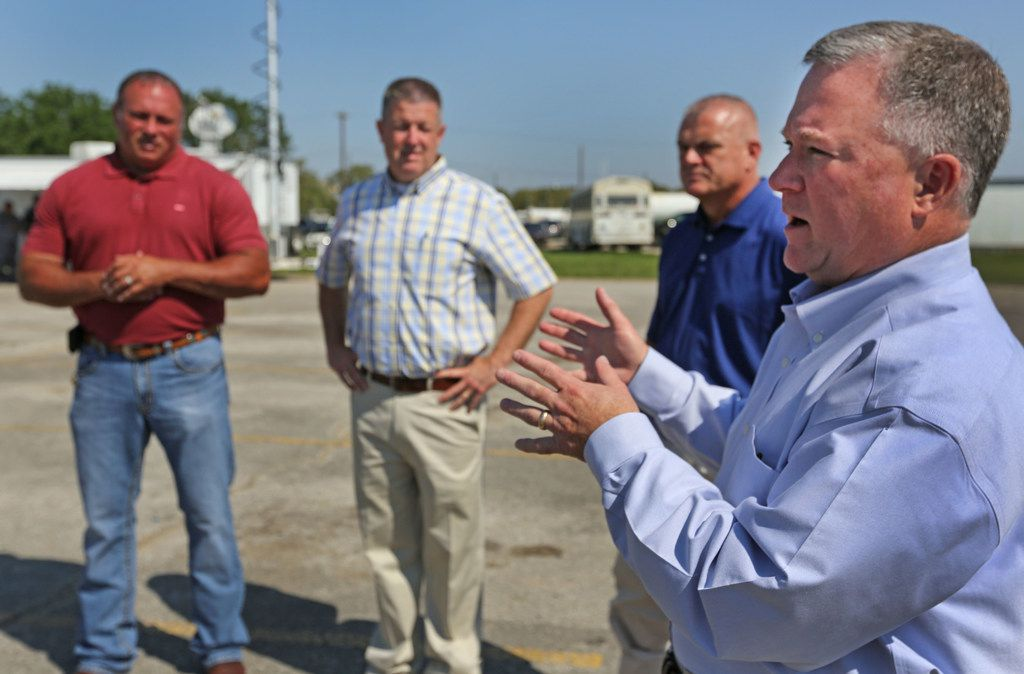 FOR BRANDI SWICEGOOD STORY TDCJ Executive Director Bryan Collier, right, explains the prison evacuation procedure along with prison officials Mike Butcher, John Werner and Virgil McMullen, left to right, after Hurricane Harvey flooded parts of the Texas Department of Corrections W.F. Ramsey Unit in Rosharon,Texas, photographed on Tuesday, September 12, 2017. (Louis DeLuca/The Dallas Morning News)