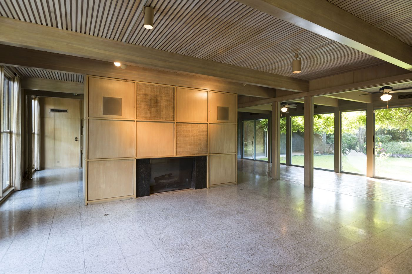 The see-through fireplace and block-panel cabinets are a centerpiece of the living room.