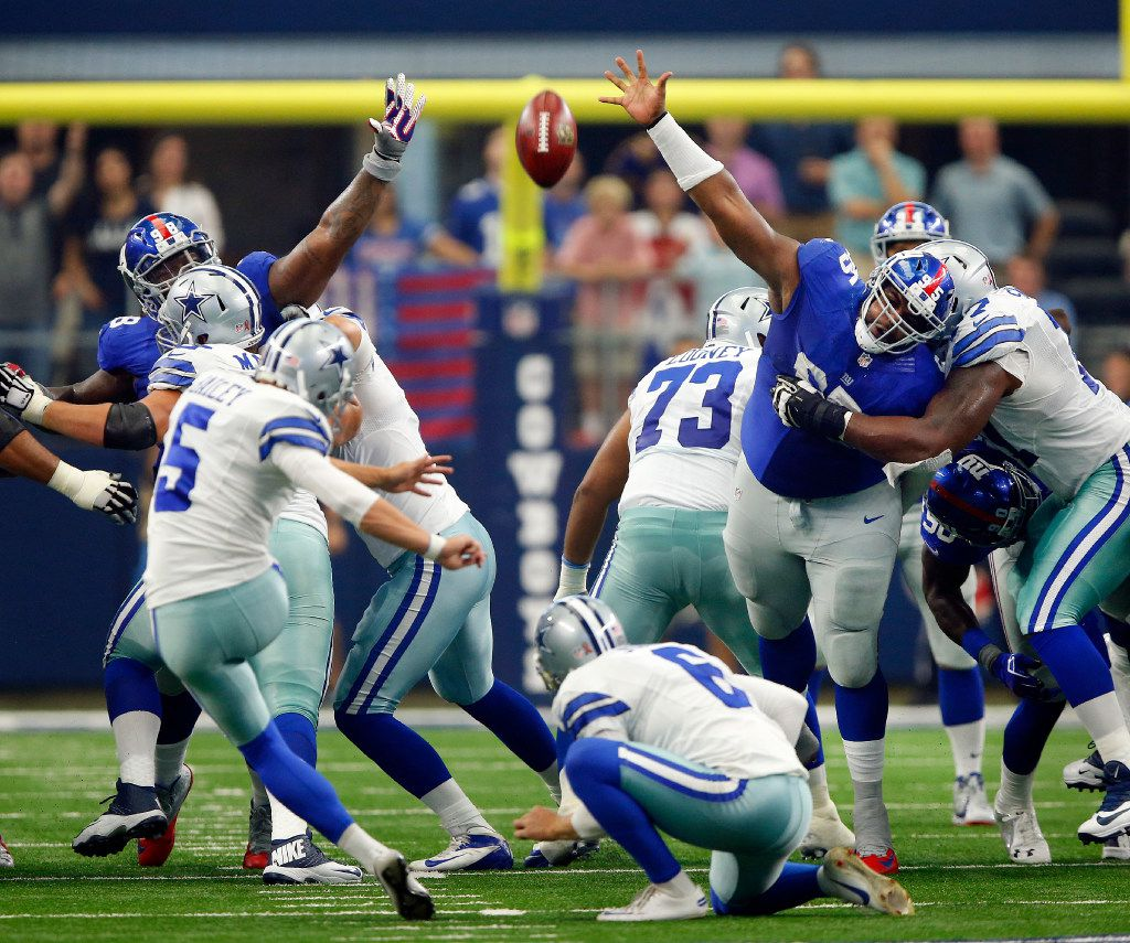 The New York Giants lineman Johnathan Hankins (95) and Damon Harrison (98) try to block a first half field goal by Dallas Cowboys kicker Dan Bailey (5) at AT&T Stadium in Arlington, Texas, Sunday, September 11, 2016. (Tom Fox/The Dallas Morning News)