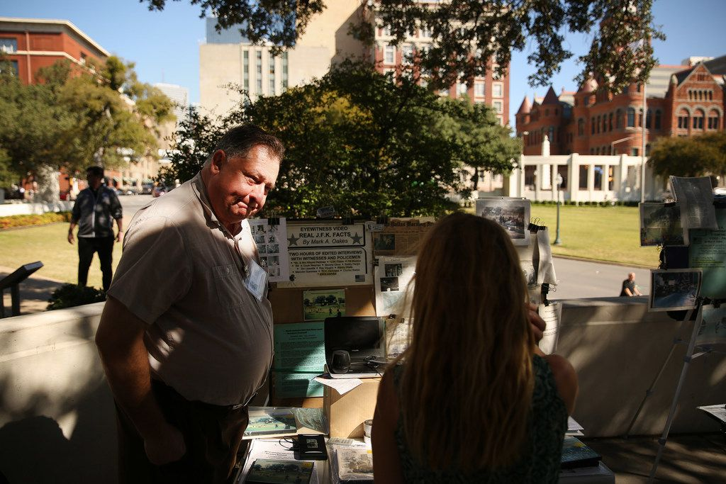 Mark Oakes, an amateur researcher and President John F. Kennedy assassination conspiracy theorist, talks to patron at Dealey Plaza in downtown Dallas, Thursday, October 26, 2017. (Andy Jacobsohn/The Dallas Morning News)