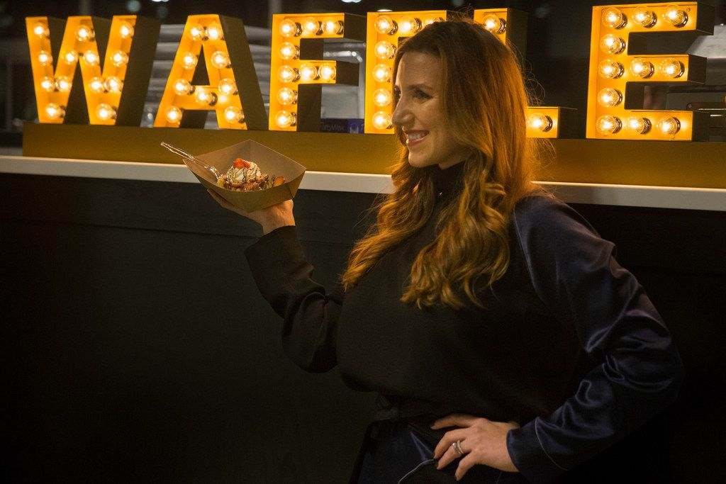 Erica Batterman poses with a Press Company Waffle in front of the company's sign at the Food Hall at Crockett Row in Fort Worth. The food hall opens Dec. 7, 2018.