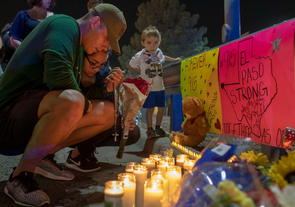 Rene Aguilar and Jackie Flores pray at a makeshift memorial on Aug. 4 for the victims of the mass shooting in El Paso on Aug. 3. The largely Hispanic city of El Paso has deep roots in Catholicism and religion in general. After the massacre that left 22 dead and two dozen injured, residents are turning to their faith to get through these times.
