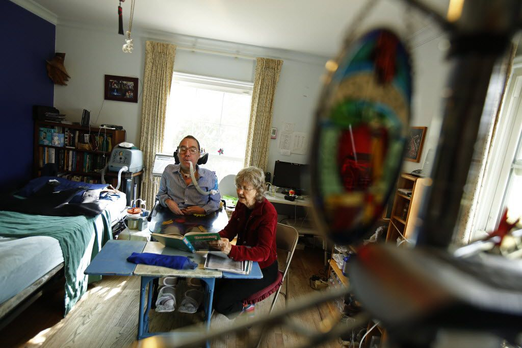 Michael Rasch and his mother Betty study the German language at their home in Denton April 25, 2014. Michael has Duchenne Muscular Dystrophy and his mother Betty is his primary caretaker at their home.