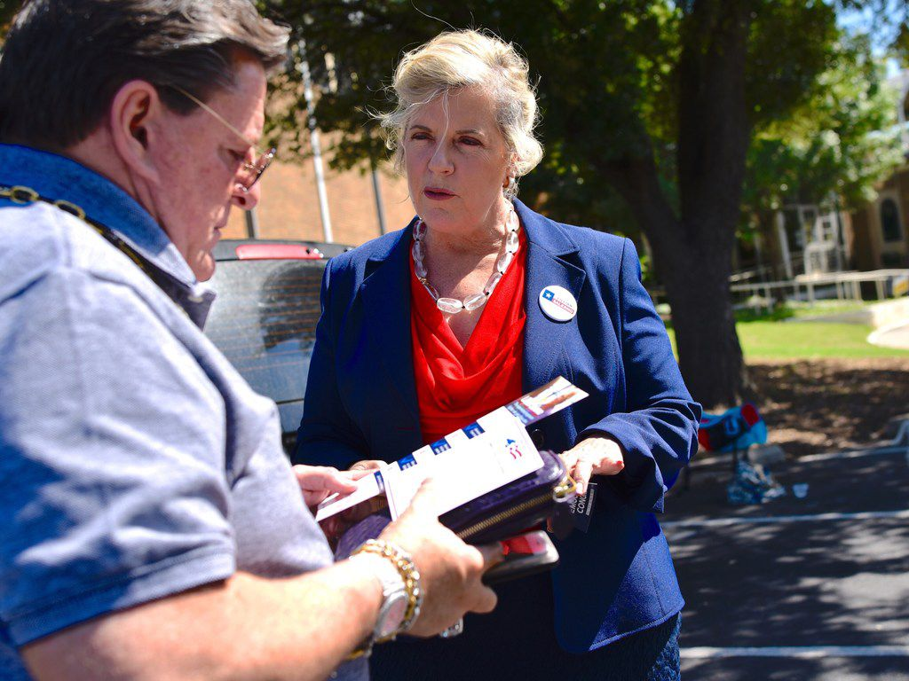 Voter Joe Pacetti meets with Lillian Salerno, Democratic candidate for the 32nd Congressional District, as she greeted voters outside Our Redeemer Lutheran Church in Dallas on Sunday.