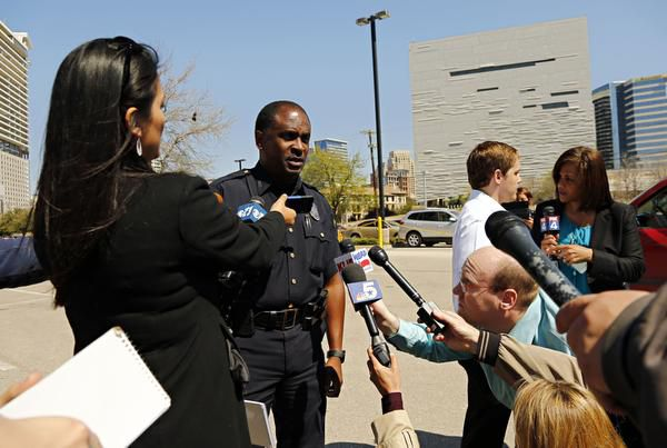 Dallas police Sgt. Warren Mitchell briefed the media during the standoff.