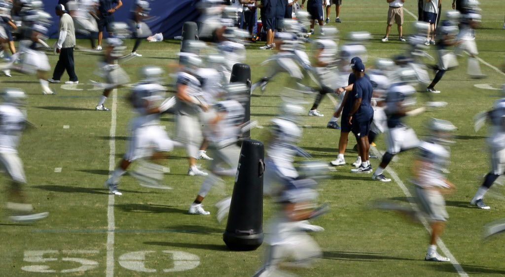 Dallas Cowboys players are a blur as they run down the field during afternoon practice at training camp in Oxnard, California, Tuesday, August 2, 2016. (Tom Fox/The Dallas Morning News)