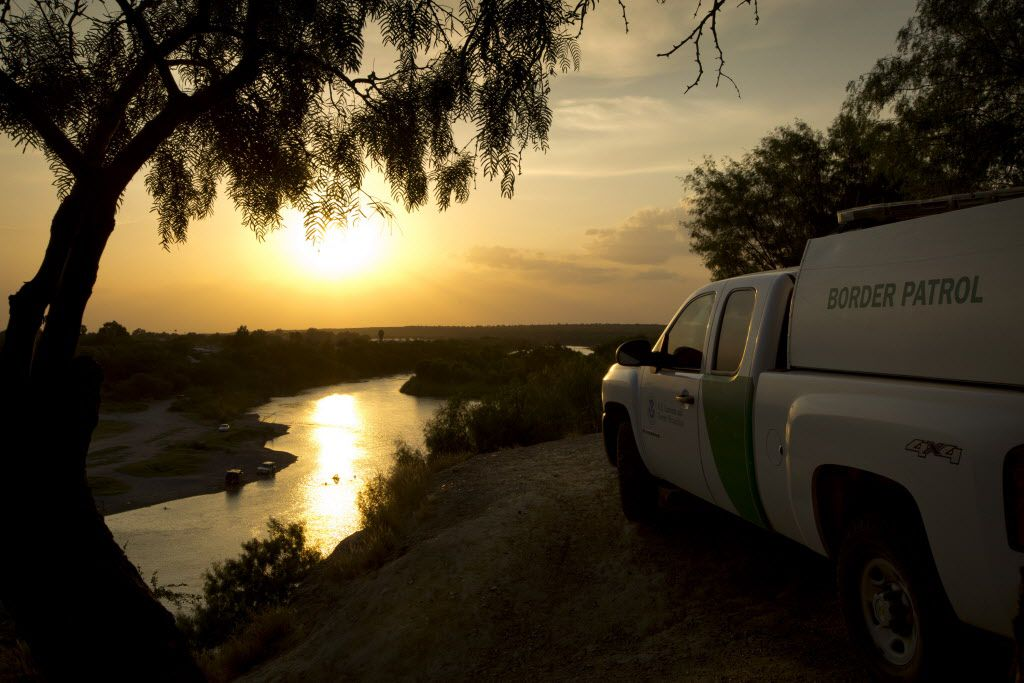 A U.S. Border Patrol agent keeps watch in Roma, which is across the Rio Grande River from Ciudad Miguel Aleman, Tamaulipas, Mexico.