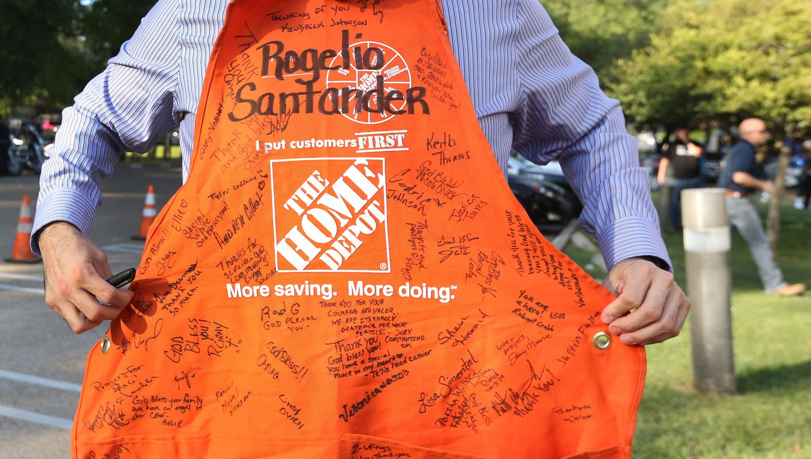 A look at the Home Depot work apron signed by the employees of the store on Forest, to be put on Officer Santander's police car, at a candlelight vigil to support Dallas Police Officer Crystal Almeida, and to honor the memory of Officer Rogelio Santander, Jr., held at the Dallas Police Northeast Division substation on Thursday, April 26, 2018.
