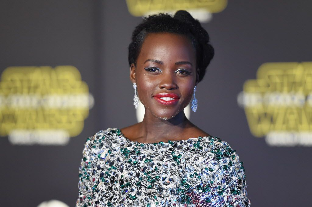 """HOLLYWOOD, CA - DECEMBER 14:  Actress Lupita Nyong'o attends Premiere of Walt Disney Pictures and Lucasfilm's """"Star Wars: The Force Awakens"""" on December 14, 2015 in Hollywood, California."""