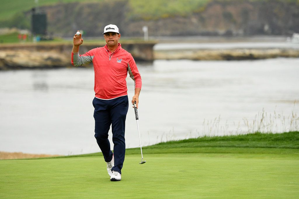 PEBBLE BEACH, CALIFORNIA - JUNE 16: Gary Woodland of the United States acknowledges the crowd on the 18th green after winning the 2019 U.S. Open at Pebble Beach Golf Links on June 16, 2019 in Pebble Beach, California. (Photo by Ross Kinnaird/Getty Images)