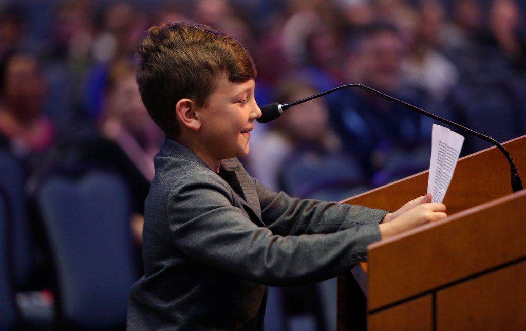 Nine-year-old Kain Hendrix is unable to hide a smile as he addresses school trustees as he spoke of the kindness and love and talent his art teacher, Stacy Bailey, shared with her students prior to her removal from the classroom last September.