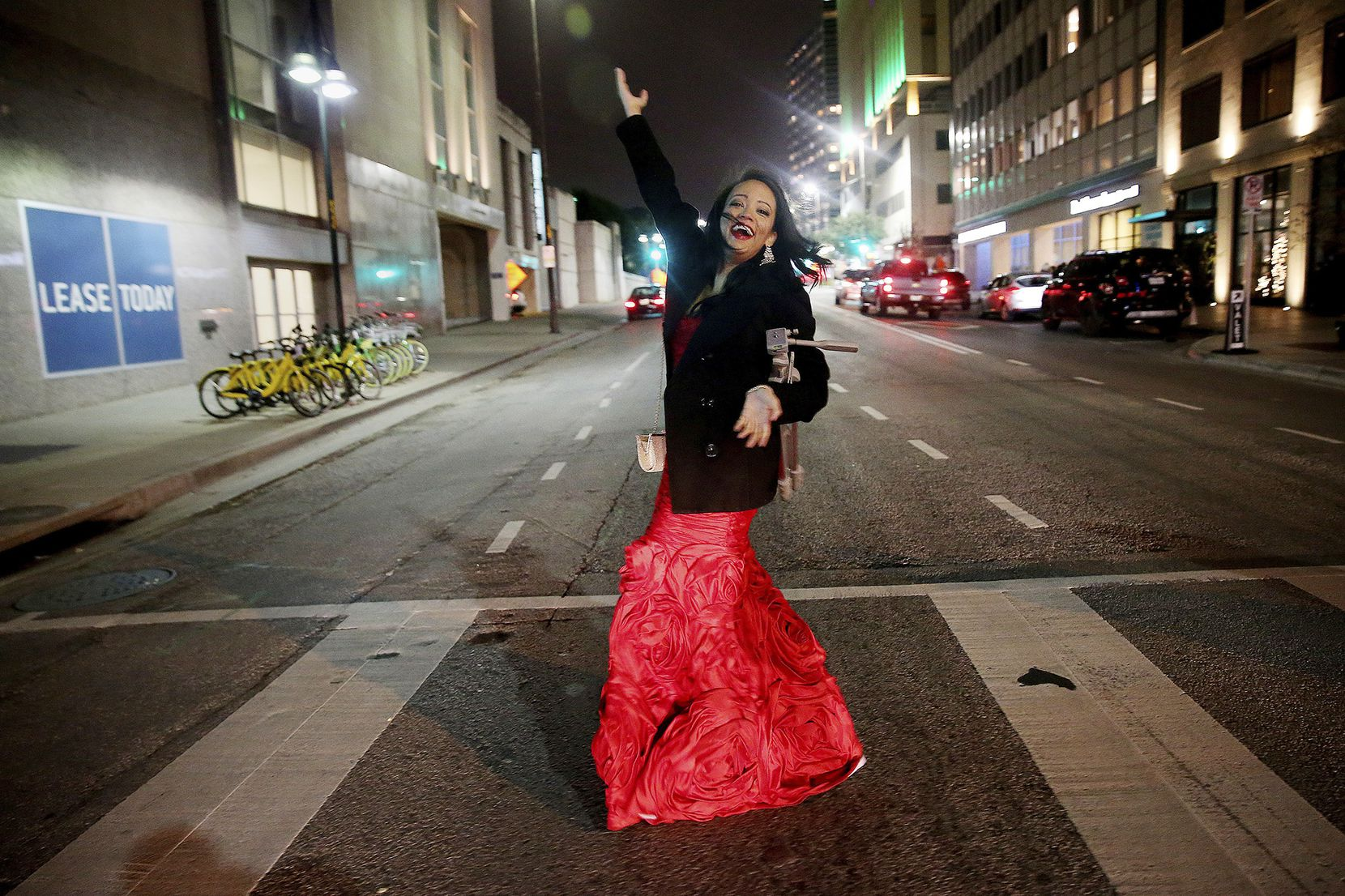Candace Perry of Addison poses spontaneously while walking to a New Year's Eve party in downtown Dallas on Sunday in freezing weather.