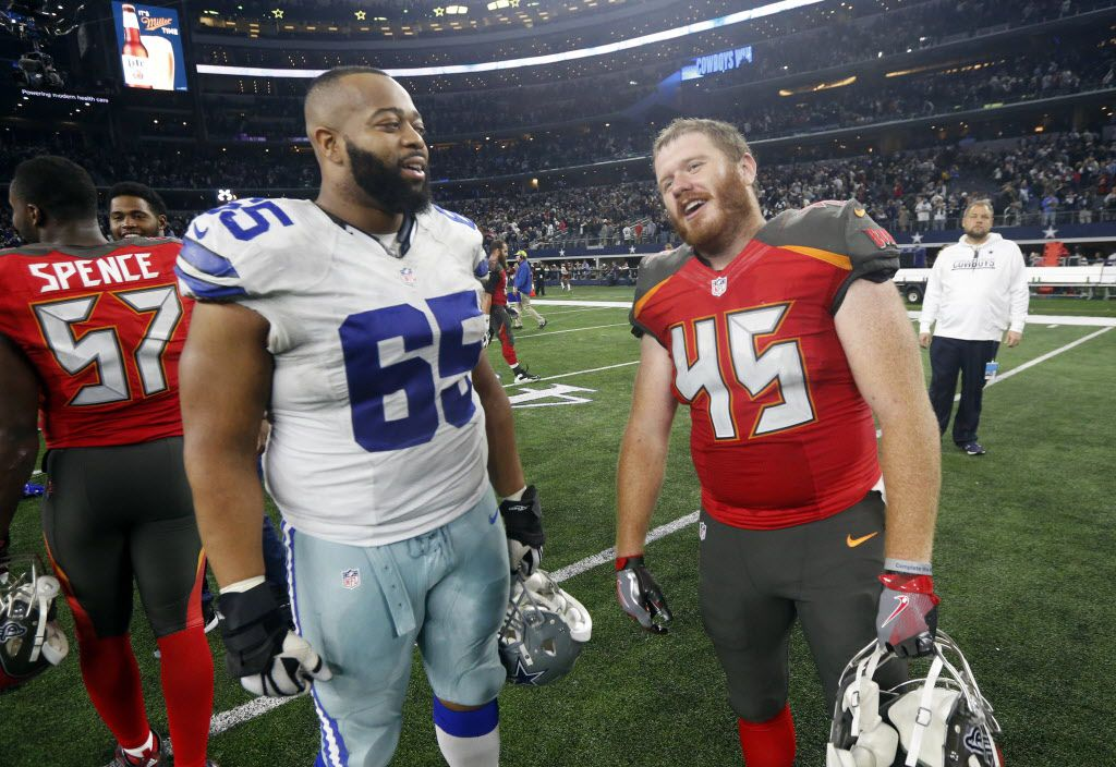 Dallas Cowboys' Ronald Leary (65) and Tampa Bay Buccaneers' Alan Cross (45) talk after their NFL football game, Sunday, Dec. 18, 2016, in Arlington, Texas. (AP Photo/Michael Ainsworth)