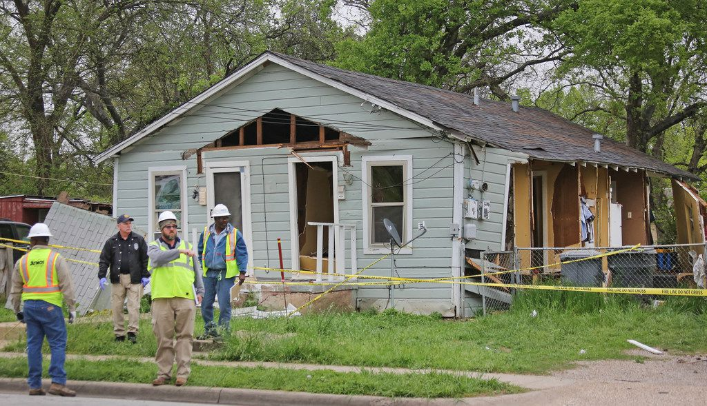 Dallas fire department and Atmos officials investigate a house explosion at 3700 Spring Avenue in Dallas, near Fair Park, on Monday, April 2, 2018.
