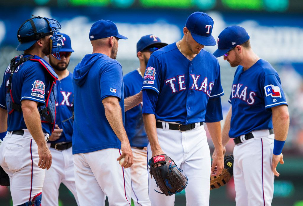 Texas Rangers starting pitcher Brett Martin (59) is taken off the mound during the first inning of an MLB game between the Texas Rangers and the Seattle Mariners on Sunday, September 1, 2019 at Globe Life Park in Arlington. (Ashley Landis/The Dallas Morning News)