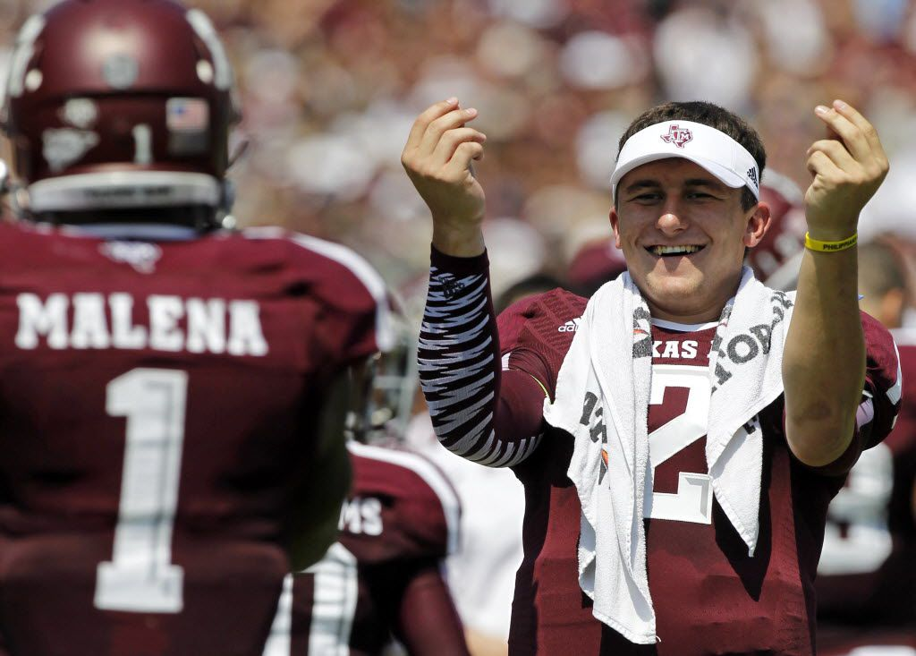 Texas A&M Aggies quarterback Johnny Manziel (2) celebrates a touchdown by  running back Ben Malena (1) as they played the Rice Owls during their NCAA football game at Kyle Field in College Station , Texas, on August 31, 2013. (Michael Ainsworth/The Dallas Morning News) 09182013xSPORTS