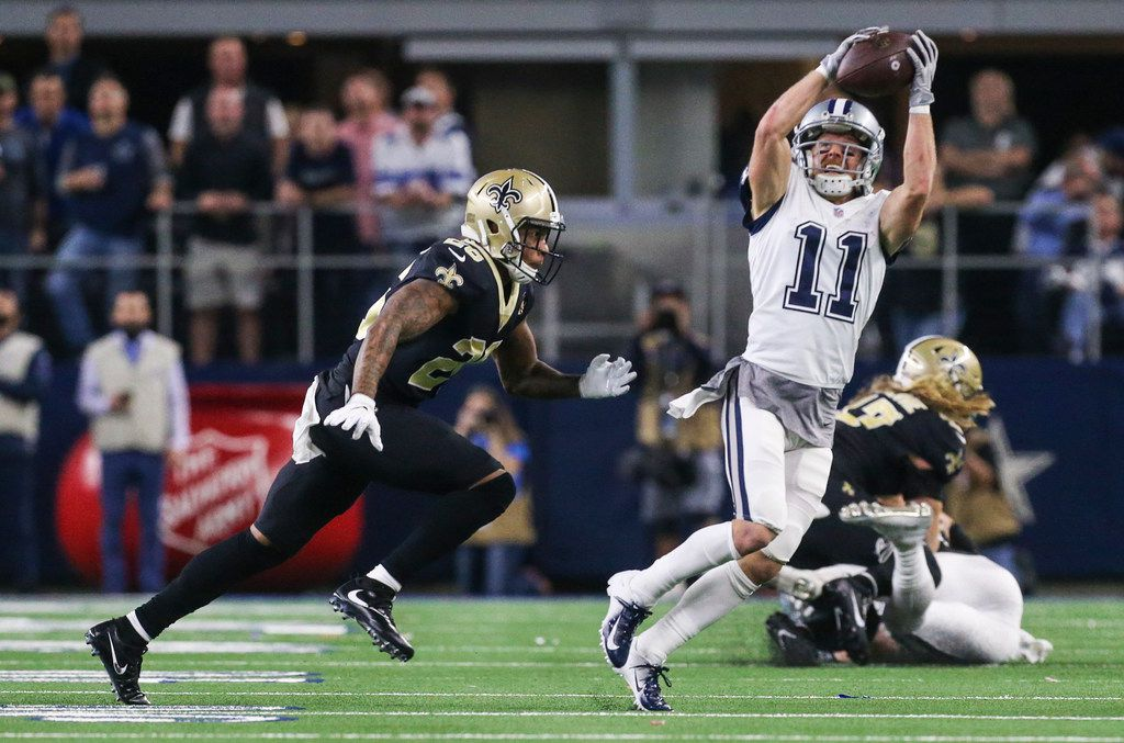 Dallas Cowboys wide receiver Cole Beasley (11) receives a pass over New Orleans Saints cornerback P.J. Williams (26) during the second half of a matchup between the Dallas Cowboys and the New Orleans Saints on Thursday, Nov. 29, 2018 at AT&T Stadium in Arlington, Texas. (Ryan Michalesko/The Dallas Morning News)
