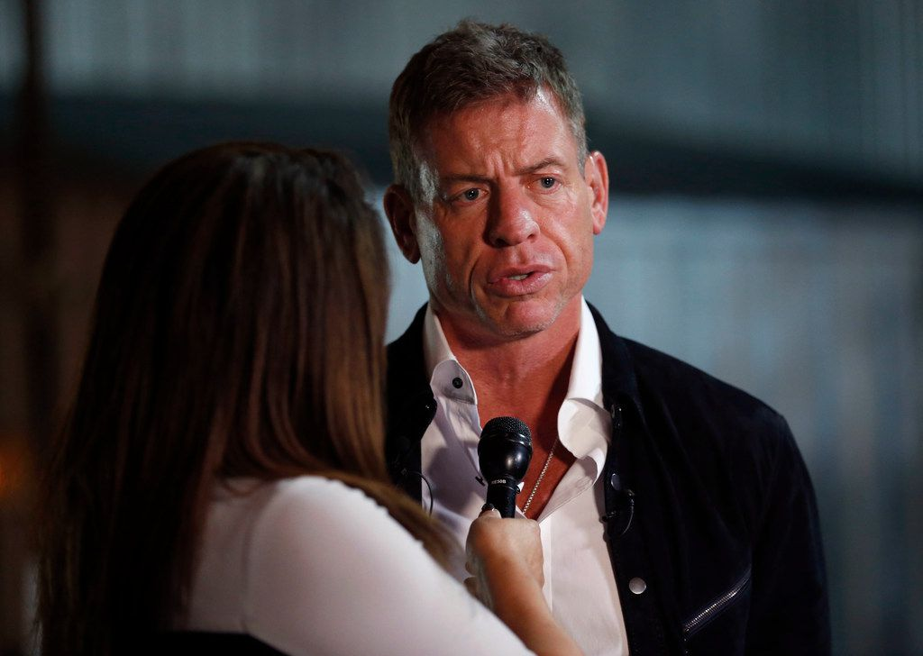 Former Dallas Cowboys quarterback Troy Aikman speaks to WFAA reporter Rebecca Lopez during United Way's Big D Gives Bash as part of Giving Tuesday at The Rustic in Dallas on Tuesday, Nov. 28, 2017. (Rose Baca/The Dallas Morning News)