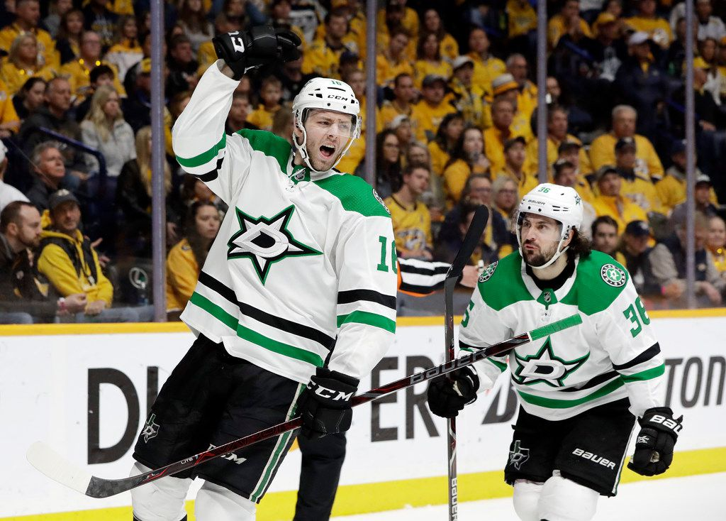 Dallas Stars center Jason Dickinson (16) celebrates after scoring a goal against the Nashville Predators during the first period in Game 5 of an NHL hockey first-round playoff series Saturday, April 20, 2019, in Nashville, Tenn. At right is Stars center Matts Zuccarello (36), of Norway. (AP Photo/Mark Humphrey)