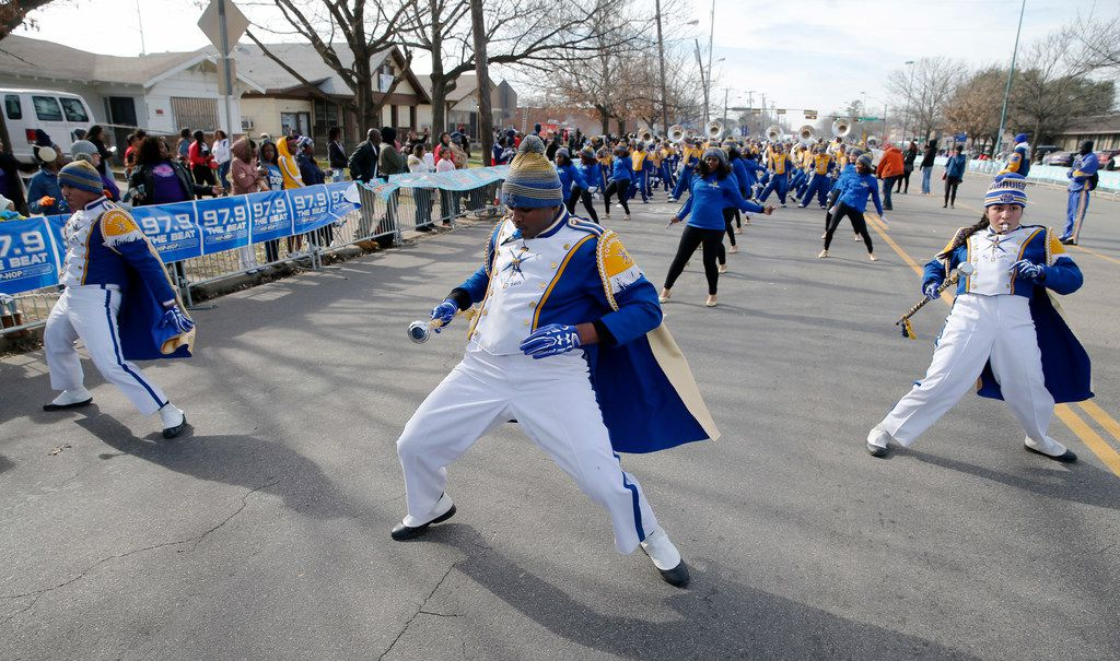 Townview Magnet Center drum majors Oscar Cruz (left), Darius Hampton-Ross (center), and Briana Cardenas  lead the band down Martin Luther King Jr. Blvid. during the 37th Annual MLK Parade in Dallas on Saturday, January 21, 2019. (Vernon Bryant/The Dallas Morning News)
