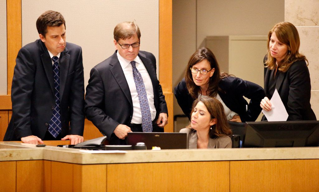 From left: Defense attorneys Cody Skipper and Toby Shook review testimony with prosecutors Lisa Milasky King and Cynthia Walker after a question from the jury during deliberations in the murder trial on Nov. 2, 2016. Court reporter Denise Carrillo pulled up the testimony on her computer.