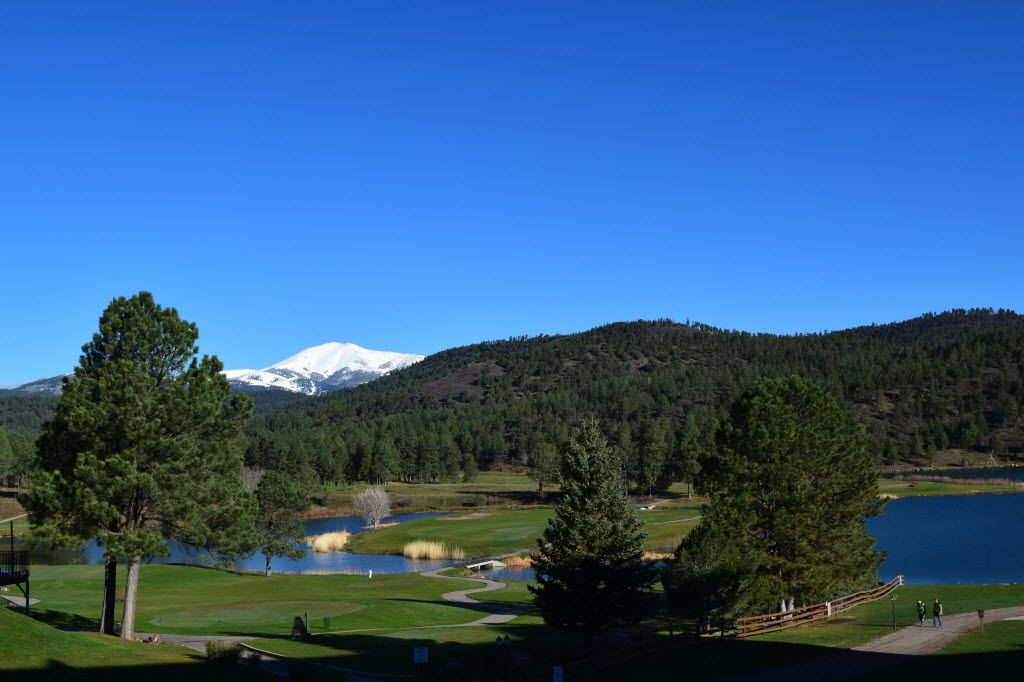 View of golf course as well as a portion of Mescalero Lake and Sierra Blanca Peak at Inn of the Mountain Gods.