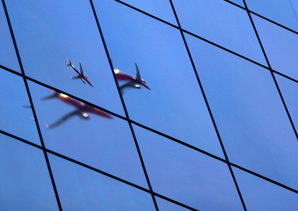 A Southwest Airlines plane is reflected in the window of a building in Dallas on on Tuesday, June 12, 2018. (Rose Baca/The Dallas Morning News)