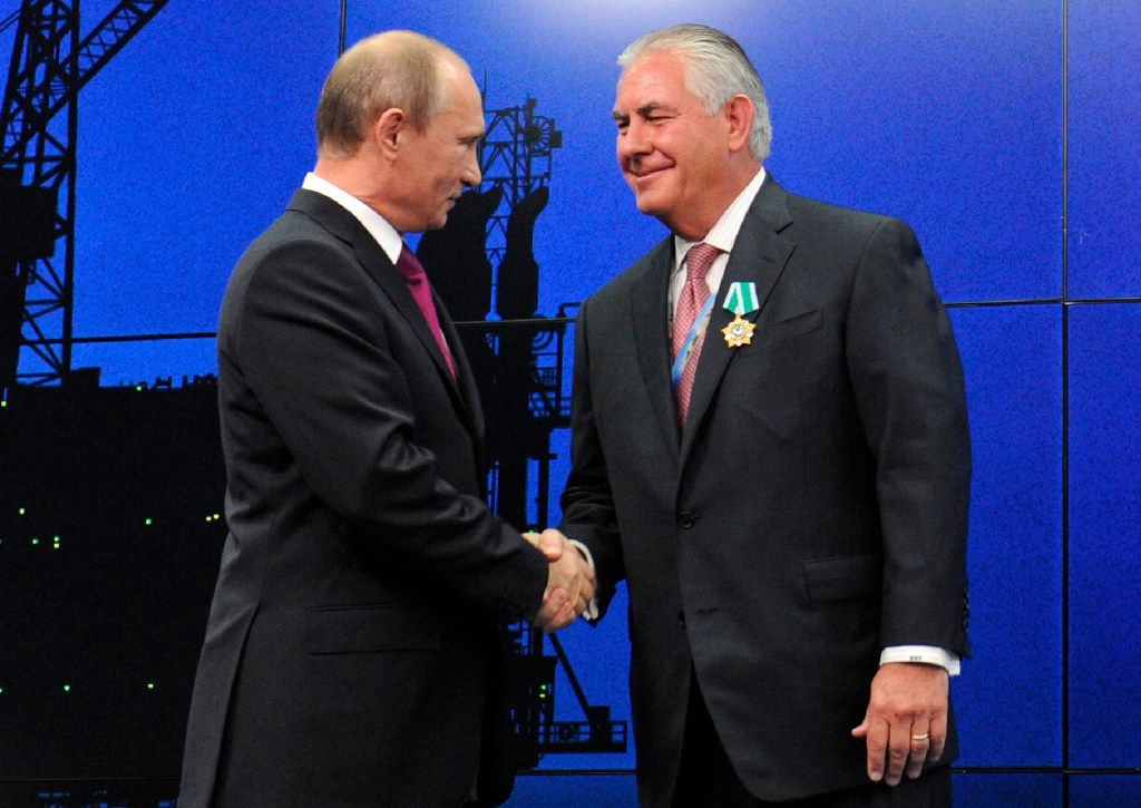 Rex Tillerson (right), whom President-elect Donald Trump has nominated for the nation's top diplomatic post, has strong ties to Russian leader Vladimir Putin. (Mikhail Klimentyev/Sputnik)