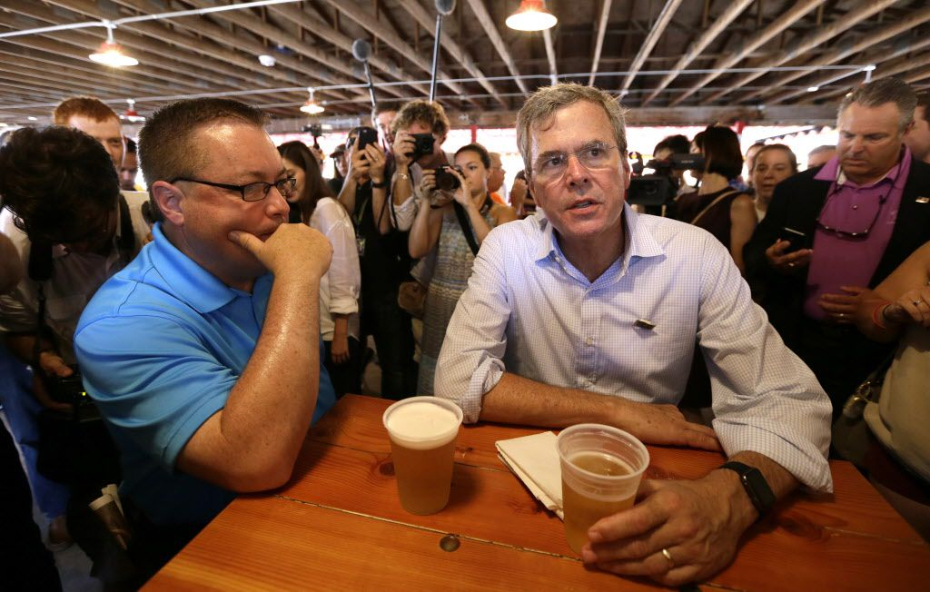 Republican presidential candidate former Florida Gov. Jeb Bush talks with Chris McLinden, of Waukee, Iowa, left.
