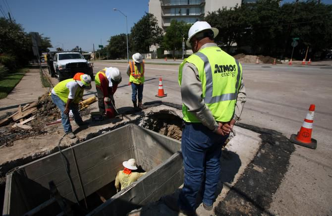 Atmos Energy workers replace old cast iron gas lines with new polyethylene pipe on Wycliff Avenue east of the Dallas North Tollway.