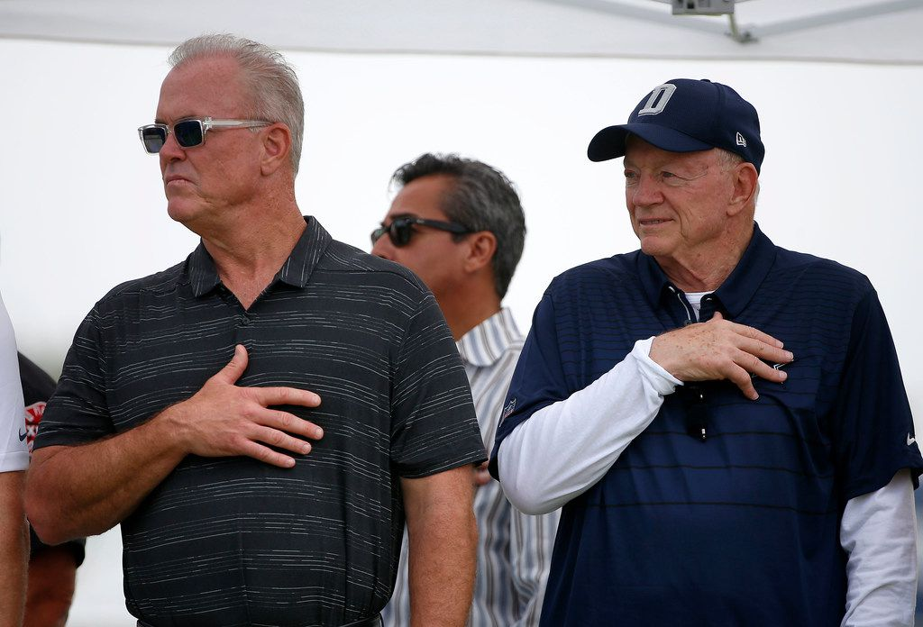 Dallas Cowboys owner Jerry Jones, right, and Executive Vice President, Stephen Jones stand for the National Anthem during the opening ceremony at the training camp in Oxnard, Calif., Saturday, July 28, 2018. (Jae S. Lee/The Dallas Morning News)